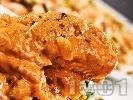 Рецепта Задушена бяла риба с доматен сос и сирене
